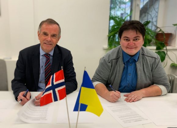 KYIVPRIDE DIRECTOR, RUSLANA PANUKHNYK, SIGNED A JOINT PROJECT AGREEMENT WITH NORWAY'S AMBASSADOR FOR 2020.
